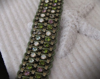 Women's Bracelet - Antique brass chain, multi-colored rhinestones and green leather cord.. Magnetic clasp. 7 3/4 inches.