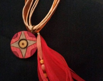 Orange tribal style ribbon necklace