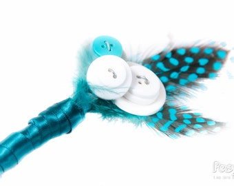 Teal feather buttonhole