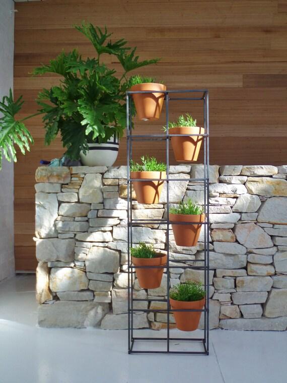 Vertical Garden An Asymmetric Design Holding Six Terracotta