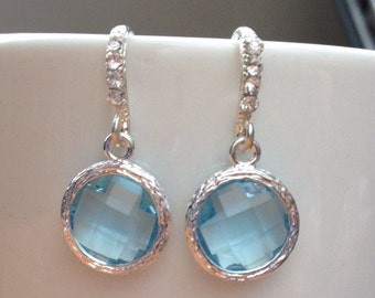 Silver and light blue round bezel framed crystal earrings