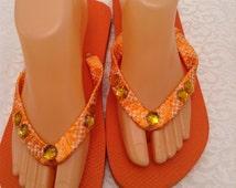 Women's  Size Medium Orange  Ribbon and Rhinestone Flip Flops Size 7-8