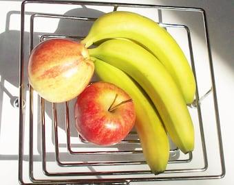 Most Modern Fruit Bowl / Square Spring Design / Adjusts to amount in Bowl / Chrome Finish / Interesting Design