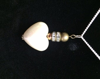 Pearl colored charm necklace