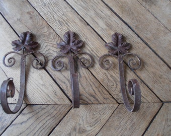 three french vintage rusted wrought iron wall hooks with vine leaf decoration