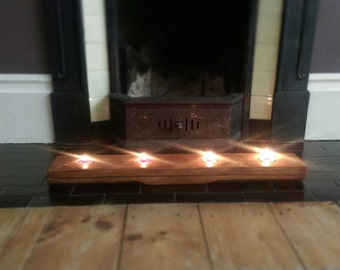 Rustic wooden tea light candle holder.