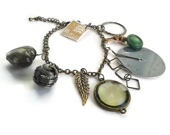 Steampunk bits and bobs bracelet - charm bracelet - steampunk jewelry - steampunk jewellery - upcycled - OOAK - green - silver - rustic