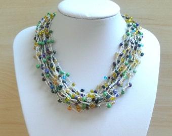 Colorful beads crochet necklace with silver string. Green, blue and yellow beads crochet on silver wire.