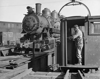 A yard engine on the turntable at the roundhouse at a Chicago and Northwestern railroad yard in Chicago 1943