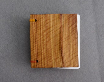 Hand made, coptic bound mini book with wooden covers.
