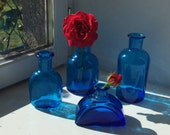 4 small French vintage blue glass bottles