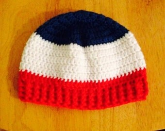 Men's beanie hat in patriotic colors of red, white and blue with ribbed edging