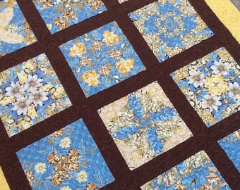 "Floral quilt  Kaleidoscope quilt throw baby quilt vivid blues yellow and brown.  All cotton.  37"" x 47"""