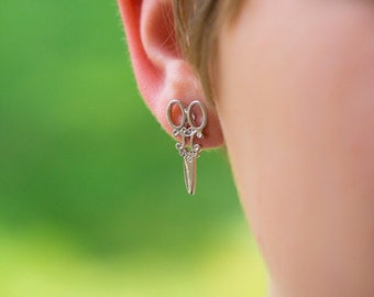 Scissor stud earrings, silver in color