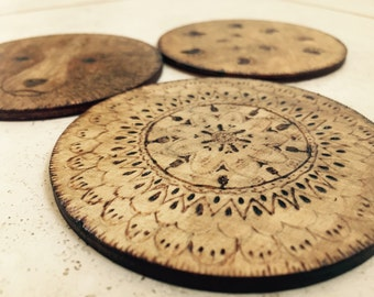Set of 4 Wooden Coasters Hand made using Pyrography technique - patterns may vary