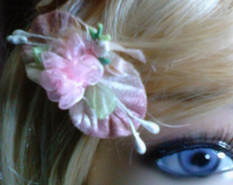 Floral french clip hair barrette with organza pink roses and embellishment on a velveteen leaf.