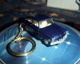 custom made keychain=1965 to 1973 vw 1600tl fastback coupe,metallic cobalt-blue w/opening doors-chrome hubcaps/repaint mint