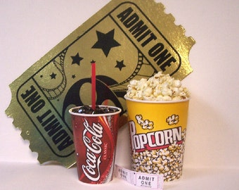 Fake food drive in popcorn coke and admit 1 sign