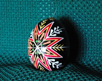 pysanky on chicken egg dark red and scarlet by theeggnpagan