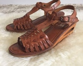 1970s wedges size 7. Vintage sandals size 7. Leather sandals size 7. Made in Brazil.
