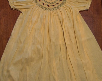 Light yellow, lady bug smocked dress for sizes 2, 3, and 4