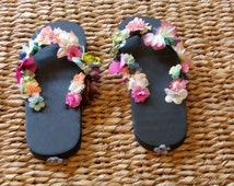 SALE:  Ladies floral and butterfly embellished flip flops, size 7 1/2 to size 8