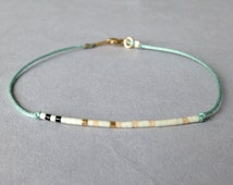 Tiny delicate bracelet / Layering beaded nylon bracelet / Sea foam
