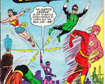 Justice League of America 24 comic book. JLA, Wonder Woman, Aquaman, Batman, Superman, the Flash, Adam Strange, DC Comics. 1963 in GD (2.0)