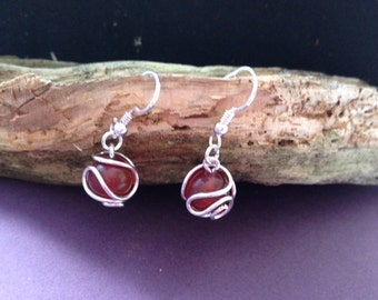 Carnelian bead wraped in fine silver drop earrings.