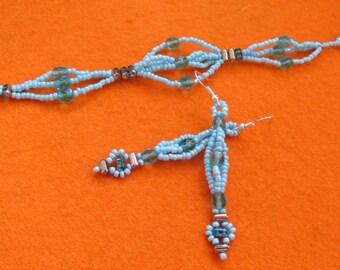 Handmade aquablue beaded bracelet and earring set