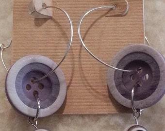 Silver hoop earrings with purple button