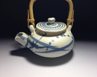 White teapot with bamboo handle