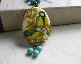 Yellow bird necklace, long chain - large pendant, blue glass beads - vintage style