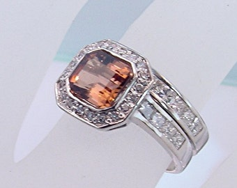 Bronze Tourmaline   6.5x6.5mm  1.41 Carats   in 14K white gold and diamond ring 1.05 carats total weight. 0423