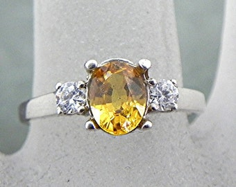 AAAA Canary Yellow Sapphire   7x5mm  1.17 Carats   in 14K white gold ring with White sapphire accents 0978 MMM