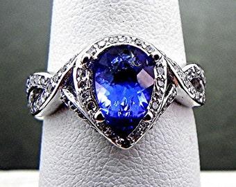 AAAA Tanzanite   10x6mm  1.63 Carats   Dark Blue Natural Pear shape in 14K white gold diamond ring (.50 carats) 1416