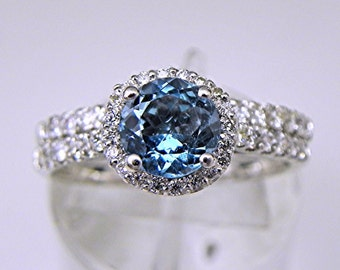 AAAAA Blue Santa Maria Aquamarine   6.0mm  .85 Carats   Round 18K white gold bridal set with .70 carats of diamonds. 1715m