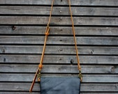 Handbag in waxed canvas with fold over top in leather   / satchel in black leather / clutch