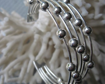 Silver Cuff with Five Wires with Stationery High Polish Silver Beads