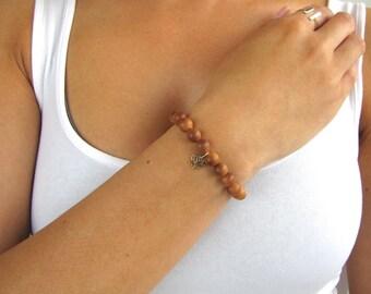 Beaded Bracelet with Lotus Charm