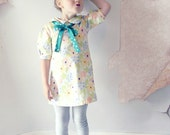 Le Petite Fleuriste Peter Pan Collar Bow Girls Shift Dress in Cream Floral Cotton with Pink Blue Flowers by Fleur + Dot