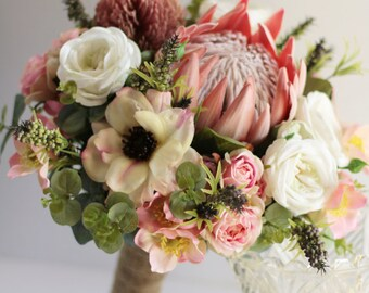 Melba - Bride's bouquet. Australian natives and cottage flowers.  Protea, banksia, gum, roses, anemones, wildflowers & wild pepper berries.