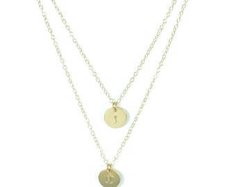 Layered initial charm necklace.
