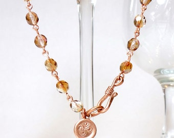 Topaz Lustre Crystal and Copper Om Charm Yoga Rosary Style Necklace
