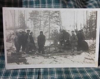 Hearty Lumberjacks taking a break to warm by the fire.
