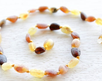 Multicolored olive shape Baltic Amber teething necklace.
