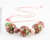 Beaded necklace, a whimsical necklace with hand rolled beads, polymer clay beads, Dutch Design
