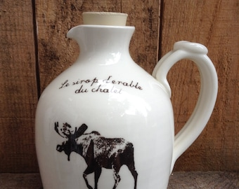 """Jug for maple syrup with a moose and a French inscription """"Le Pichet à Sirop du Chalet"""""""
