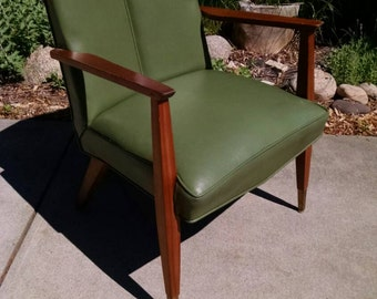 Vintage avocado mid century chair with unique V back.