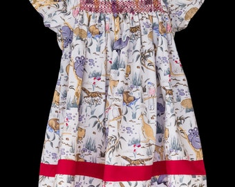 Hand-smocked polycotton top, age 8 to 10, native Australian animals and birds on an ivory background